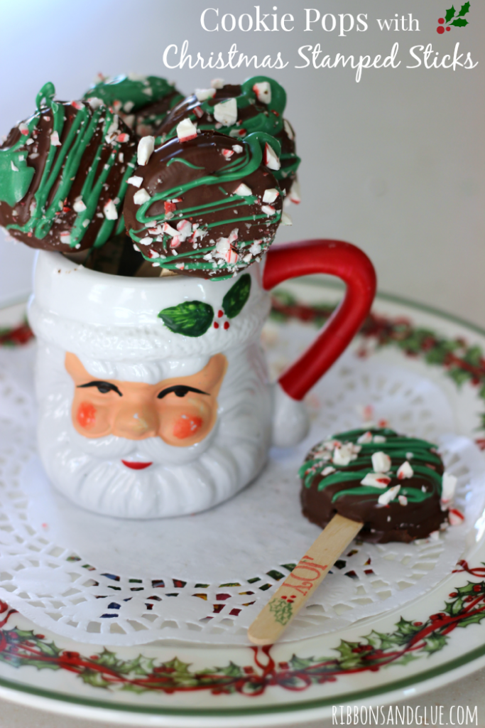 Holiday Cookie Pops made with chocolate covered OREO cookies stuck on wood craft sticks stamped with Christmas Stamps. #SpreadOREOCheer @kroger #ad