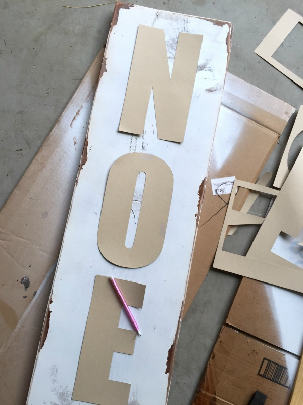 Make paper stencils to trace letters on to wood boards.