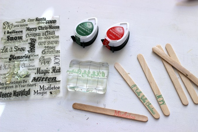 Stamp craft sticks with Chriatmas Stamps to make Cookie Pops. Perfect detail to add on to holiday treats