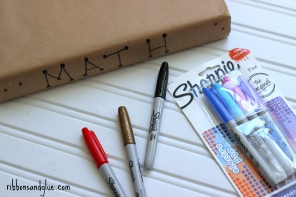 Cover textbooks with kraft paper then decorate with Sharpie markers. Funs school project!