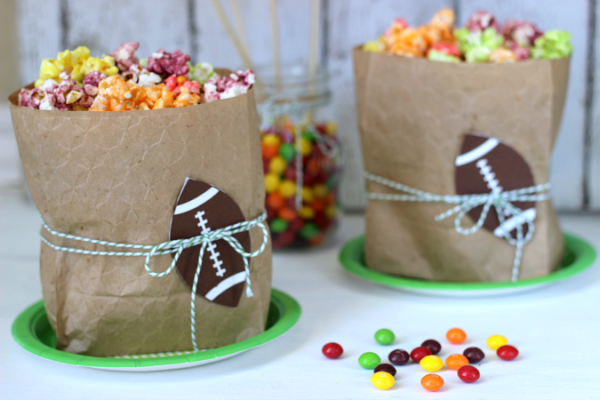 Skittles Popcorn in embossed paper bags and football die cut. Perfect for Super Bowl party!