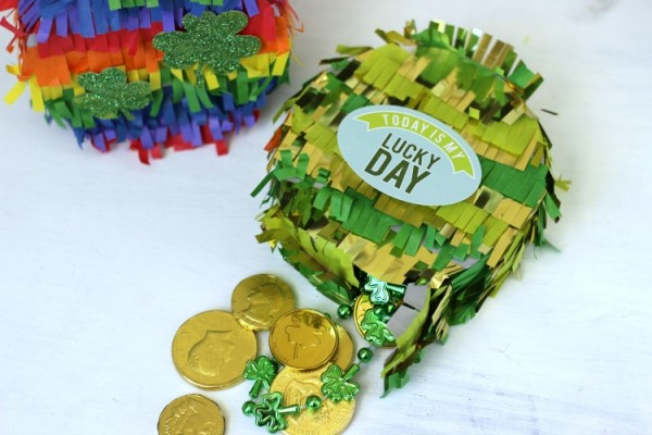 St. Patrick's Day Pinata filled up with gold and chocolate coins and green beads.