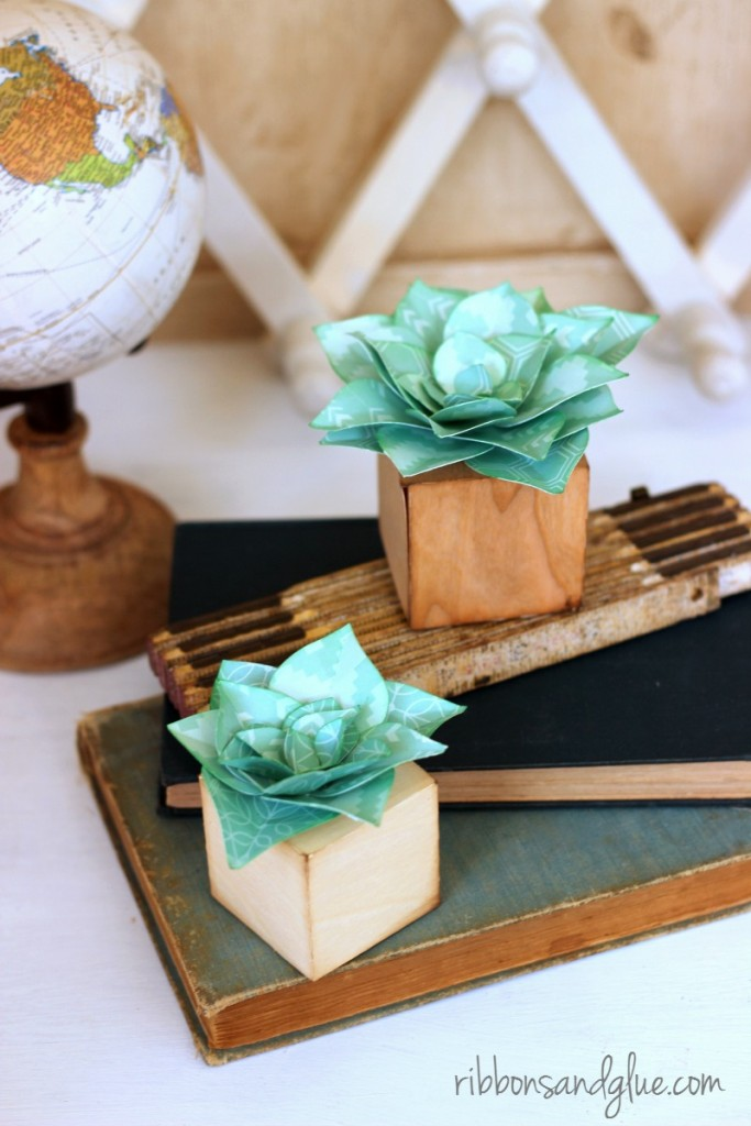 Pretty Paper Succulents made with Silhouette and scrapbbooking paper adhered on to wood veneer paper blocks. Such a pretty home decor craft that will last a long time.