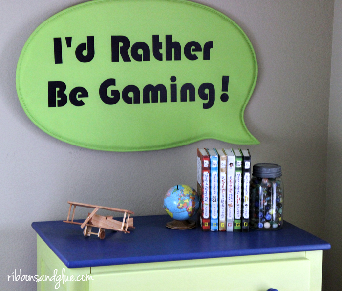DIY I'd Rather Be Gaming Sign made with heat transfer vinyl, Silhouette Cameo and an IKEA sign. Easy craft idea for any Tween Boys Room
