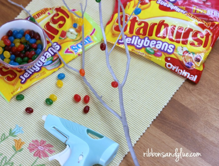 Hot glue Jellybeans on to tree branches to make Jellybean Trees. Easy Easter Craft decorating idea.