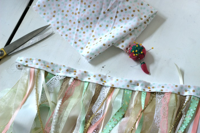 How to make a DIY Shabby Chic Ribbon Flag. Love the look of pretty ribbons hanging on vintage windows or shabby chic furniture.