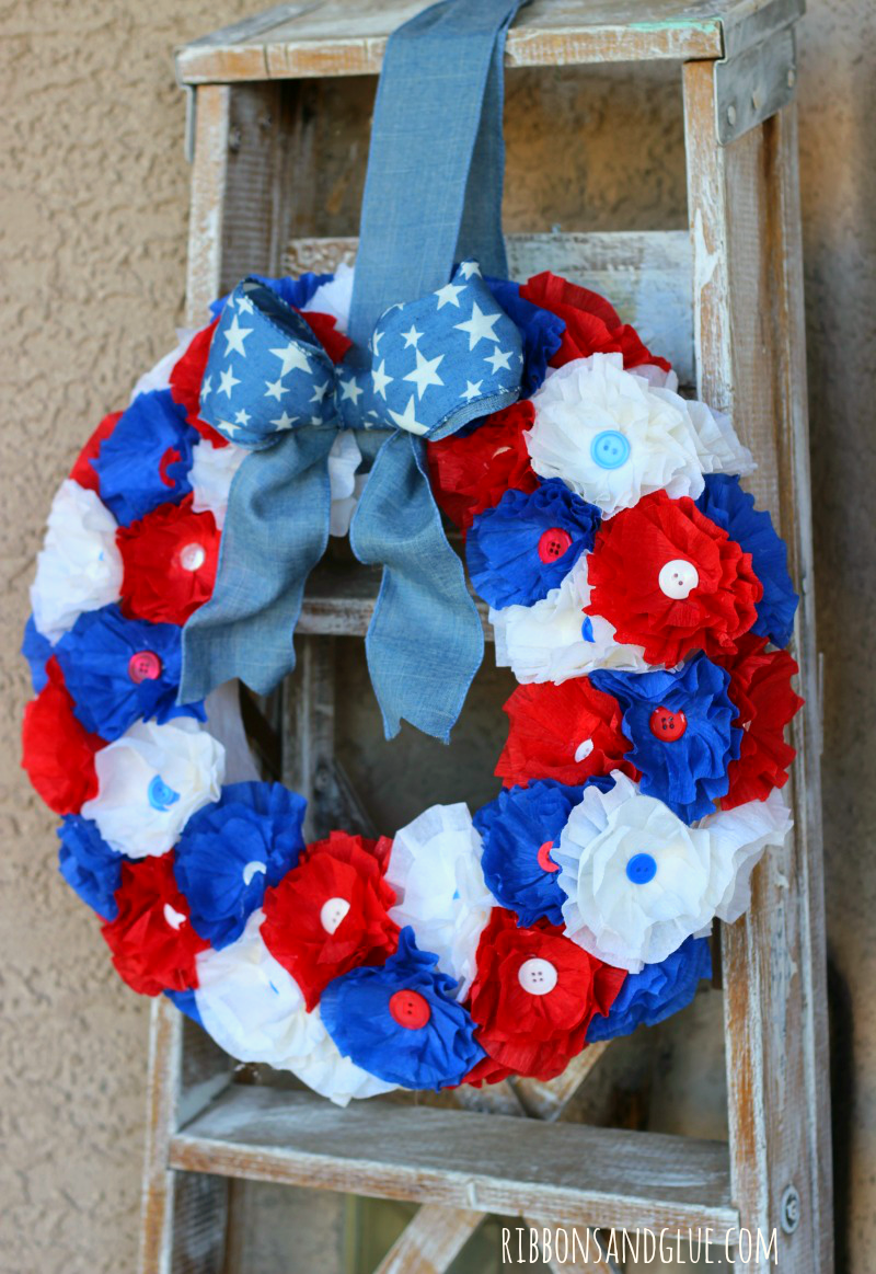 How to make a Patriotic Crepe Paper Flower Wreath. Crepe paper flowers are an inexpensive way ti make a beautiful statement. #makeitfuncrafts