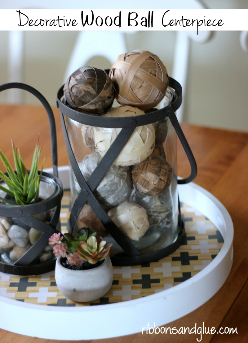 Decorative Wood Ball Centerpiece made with FloraCraft® Make It: Fun® Foam Balls and wood veneer paper. Easy, rustic DIY table centerpiece piece idea.
