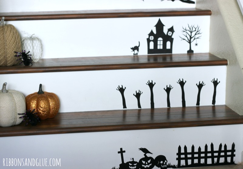 Halloween Vinyl Staircase. Create a Halloween Staircase by using a die cutting machine to cut out black vinyl Halloween shapes. Easy Halloween Decor idea.