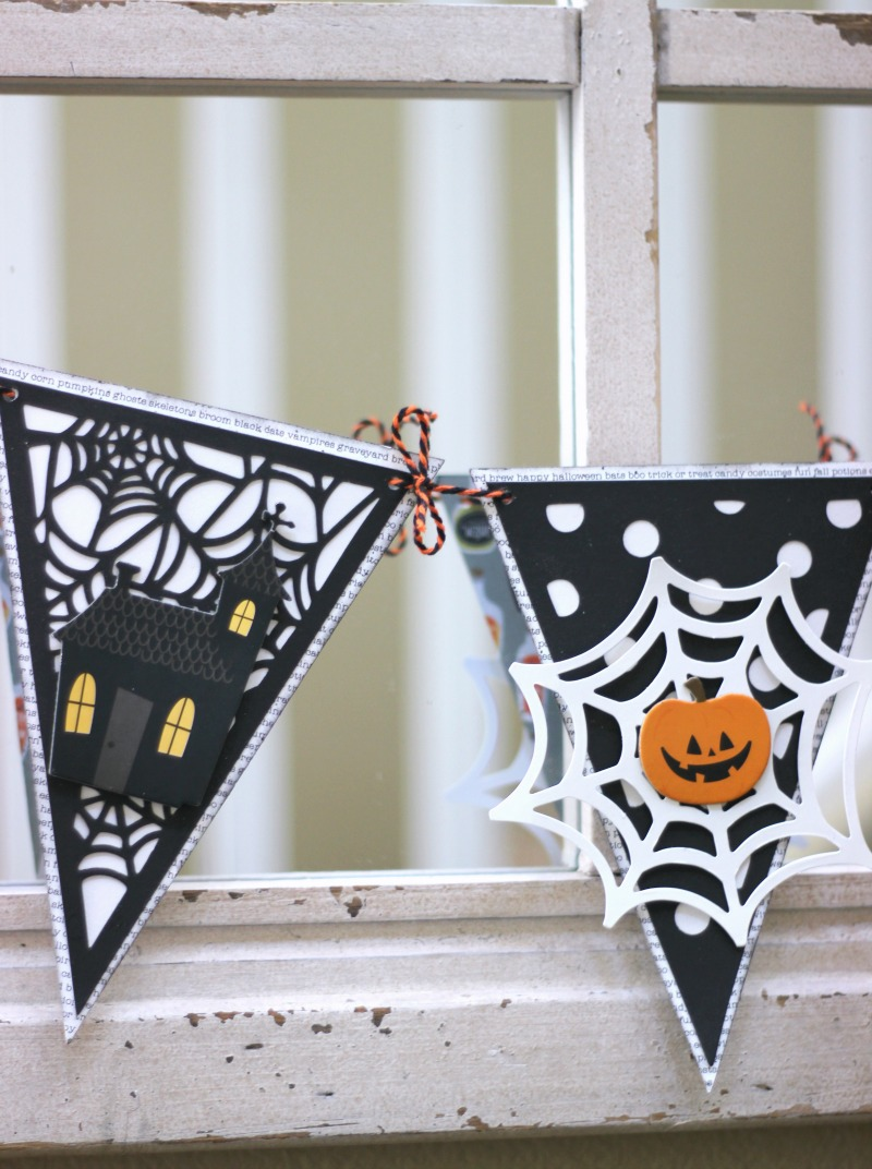 Easy Halloween Banner made from a pre-made banner embellished with Halloween stickers and shapes
