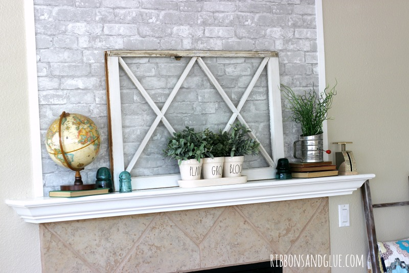 Simple and Temporary Fireplace Makeover using rempvable faux brick wallpaper from WallPops