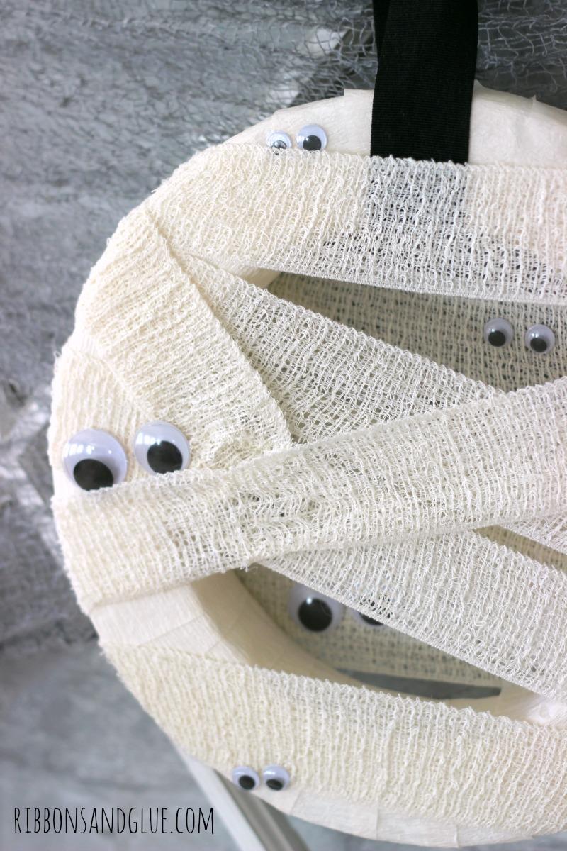Halloween Mummy Wreath made from a foam wreath, decorative gauze and a googly eyes.
