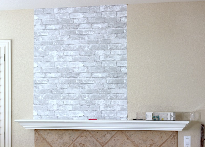 Simple and Temporary Fireplace Makeover using faux brick wallpaper from WallPops
