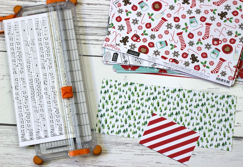 How to make a Holiday Gift Box Bag out of scrapbooking paper and a score board.