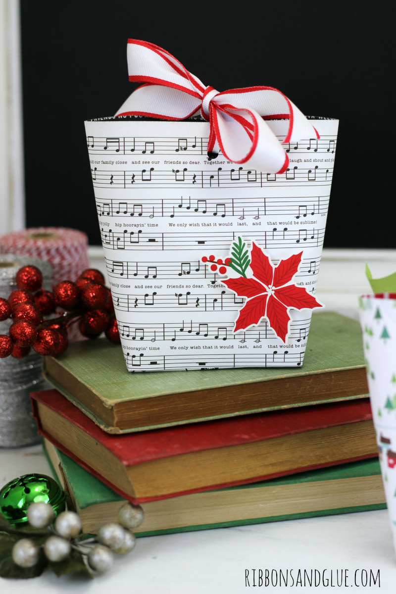 All you need to make this Easy Gift Box Bag is scrapbooking paper and a score board. Perfect little box bag to fill up with Holiday treats.
