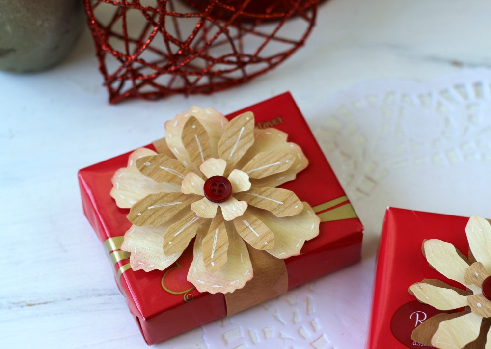 Valentine Candy Box Wraps. Turn a simple box of candy in to a pretty gift by wrapping them with wood paper tape and adhering a pretty wood paper flower on top.