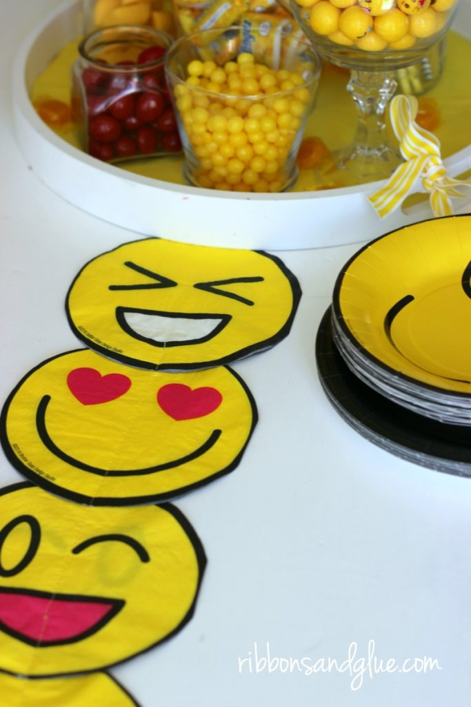 Create this simple DIY Emoji Table runner out of emoji napkins