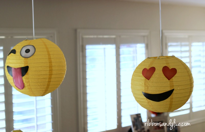 Yellow lanterns with printable emoji faces.