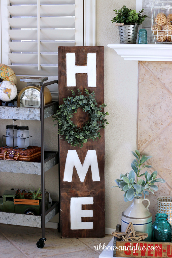 Create your own Farmhouse Home Sign with supplies you probably have on hand. #farmhouseisgn #boxwoodwreath