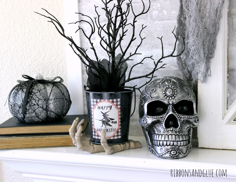 Decorative Skulls on Halloween Mantel